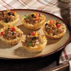 Easy to make but mouthwatering enough to serve as Hors d'Oeuvres, these little tarts are party-perfect... but fair warning: Mini Sausage Tarts will disappear faster than you can make them.