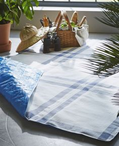 A picnic blanket made from IKEA blue bags and tea towels