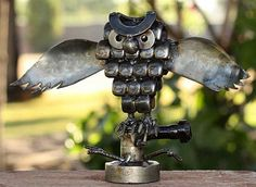rustic horned owl recycled auto parts armando rami