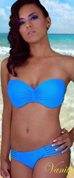 $49 www.vanityswimwear.com Blue bandeau bikini with elastic cutout back and sides. The top has ruching in front with padded wired cups and 6 straps in back. Bottoms have 5 straps on sides. Includes removable tie straps. Material: 80% Nylon, 20% Lycra Lining: Fully lined Recommended dry clean only