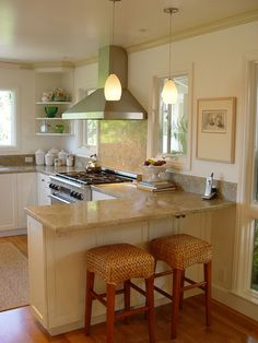 Kitchen peninsula using shallower, tall cabinets (same height as standard base) facing in or out of kitchen, but leaving space for chairs? Covers the end cabinet issue....
