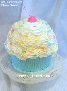 Learn to make a GIANT cupcake cake in MyCakeSchool.com's video tutorial! {Member Section} No special pans required.