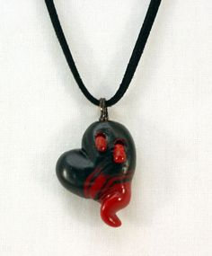 Vampire Heart polymer clay heart pendant necklace by Tamara Dozier. Available on Etsy, $25.00 https://www.etsy.com/listing/81427837/vampire-heart-polymer-clay-heart-pendant?ref=shop_home_active