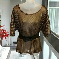 Metallic Gold and Black top Super cool top black and gold metallic top. Perfect for the holiday parties, pair with leggings and thigh high boots!!  Seen in picture #2, see-thru material A Loosely fitted medium, could be worn with belt. Brand new, tag is attached 100%polyester  **Belt is not included, just used to show an option to style this top*** Tops