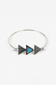 Aztec Triple Triangle Bracelet - Silver  Description This  tribal  pattern etchings and stone centerpiece, glossy wi...   https://nemb.ly/p/NyQd9__rTe