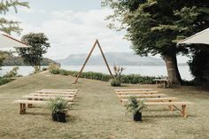 lakeside weddng with minimal triangle backdrop