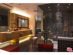 Amazing bathroom - spacious shower with multiple heads, shapely counter Beverly Grv, Beverly Hills, CA Glass Corner Shelves, Corner Shelf, Modern Master Bathroom, Wood Counter, Amazing Bathrooms, Double Vanity, Beverly Hills, Home Improvement, Design