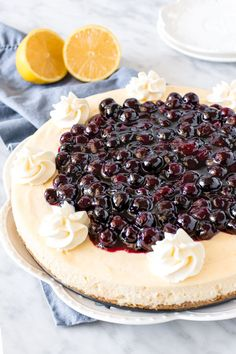 This lemon cheesecake with blueberry compote is ridiculously creamy & bursting with fresh spring flavors. The cheesecake has a delicious lemon flavor that pairs perfectly with the sweet berry topping. #lemoncheesecake #cheesecake #lemon #blueberrysauce #lemonblueberry #spring #summer #homemade #recipe from Just So Tasty Lemon Blueberry Cheesecake, Blueberry Topping, Blueberry Compote, Blueberry Sauce, Cheesecake Desserts, Dessert Recipes, Bar Recipes, Homemade Recipe, Yummy Treats
