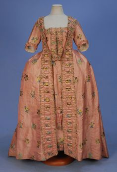 SILK BROCADE ROBE a la FRANCAISE, c. 1750. Red and white striped silk open gown and petticoat brocaded with floral sprays in yellow, blue, p...