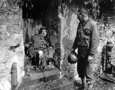 "The dead German soldier in this June 1944 photo was one of the ""last stand"" defenders of German-held Cherbourg. Captain Earl Topley, right, who led one of the first American units into the city on June 27, said the German had killed three of his men."