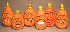 Pumpkin Family Wood Carving. What a great bunch of expressions!