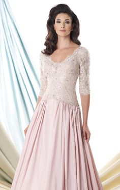 Look ethereal as a goddess in Mon Cheri Montage 114929W. This evening gown showcases a plunging neckline with three quarter length sleeves. The fitted bodice is wrapped with rich lace that leads to an inverted basque waist. The flared skirt is cut at floor length hemline.