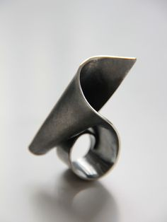 "ALINA ALMOREAN -ROMANIA/ FRANCE VICTORY RING  This ring is a one-of-a-kind 72.8 gram oxidized sterling silver sculpture. I call it ""mine"" because it is the original and my favourite from the collection of folded metal rings which started in 2008"