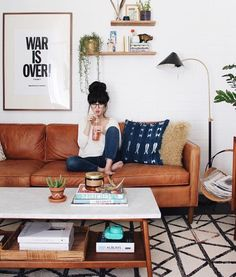 "Like the couch and rug and coffee table - not a huge fan of the ""statement"" art or the floating wall contents. A little ""too"" mid century modern/cute"