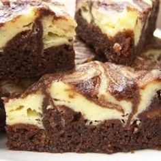 Cheesecake Brownies. So easy! Mix 8oz of cream cheese, 1/3 cup sugar and 1 egg together. Dollop on top of your normal brownie batter that you use. Swirl together, bake, enjoy!