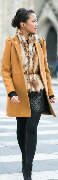 mustard coat, fur vest, and black leather quilted skirt