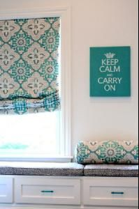 Porter Design Company Adorable turquoise blue girl's bedroom design with crisp white walls, turquoise blue custom fabric roman shade, white built-in window seat with storage, charcoal gray china seas Java Java fabric cushions, turquoise blue bolster pillow and turquoise blue Keep Calm & Carry On print.