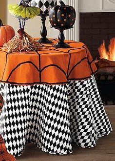Show your true colors this Halloween with the stylish Harlequin Faux Dupioni Round Tablecloth.