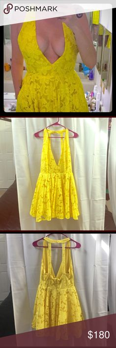 Bebe Deep plunge, yellow lace dress. Size 8 Pretty yellow, deep V-plunge dress that looks perfect when worn. A fun strappy back. It's brand new, no tags. Only wore to try on at home. Deserves a home where it will be worn and shown off! Size 8, Bebe. PRICE IS FIRM. bebe Dresses