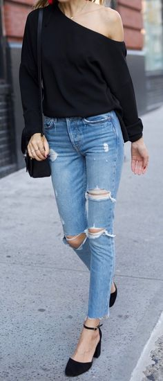 Asymetric Black Sweater // Destroyed Jeans // Black Pumps                                                                             Source