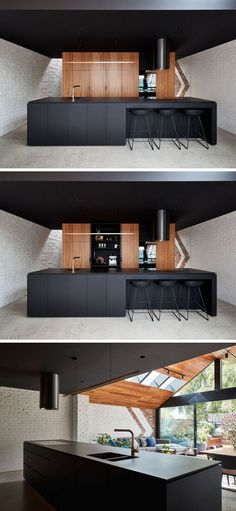 "former ""workers cottage"" was transformed into an updated livable space This modern kitchen features a black island and ceiling, and wood cabinets.This modern kitchen features a black island and ceiling, and wood cabinets."