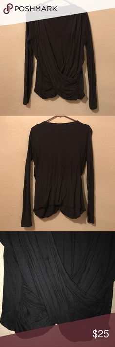 Anthropologie wrap top Great top!! Worn a few times but still in excellent condition. Brand is akemi + kin. 60% cotton, 40% modal. Can be dressed up or down. Accepting all reasonable offers but no trades! Anthropologie Tops