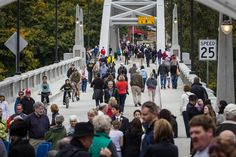 Thousands turned out over the weekend for a chance to walk the 1922 Arch Bridge following its 21-month renovation by ODOT. Photo by Christopher Communications.