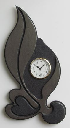 Unique Contemporary Modern Art Wall Clock - designed to be hanged in 4 different ways.