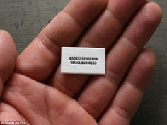 """1"""" wide business card. Name and # only on back."""
