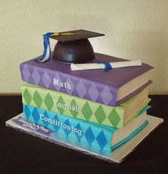 - Fondant covered cakes.  Top of hat, tassel diploma are gumpaste.