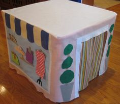 this would have to be a little more boyish for my house! DIY felt card table play house