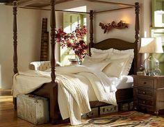 Habitación con cama con dosel.