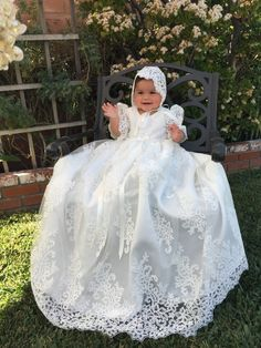 Stunning Alencon Lace Christening Gown, Baptism dress, Girls Christening Gown set  If you desire the best for your dear one, then look no further. You have come to the right place and we are glad that you have done your research well. Please do checkout our customer feedback reviews.  GOWN DESCRIPTION:  This stunning and long gown has an Alencon Lace overlay, Satin underlay and a cotton lining.. This makes the gown full and fluffy. The back of this gown is open. So, when you hold the baby…