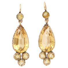 Victorian Gold and Citrine Earrings Evoke Sunny Days. Let the sunshine in any time of the year with Victorian citrine earrings that flash light and are light on the ear as well. Quite modern in style, the earrings fit attractively in to any outfit from denim to your party black dress. Four round citrines one at top three at bottom, embellish a faceted pear shaped stone. All are set in an open setting of 15kt . From the Glorious Antique Jewelry Collection