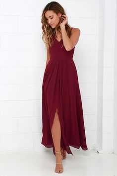 Show of Decorum Wine Red Maxi Dress! A modest triangle bodice takes shape supported by wide, adjustable straps and tailored by princess seams along the woven fabric. Box pleats below the fitted waist introduce a sweeping maxi skirt with center slit. Hidden back zipper/hook clasp. Fully lined. Self: 100% Polyester. Lining: 98% Polyester, 2% Spandex. Dry Clean Only. Imported.