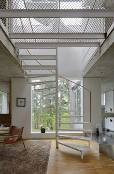 I love this mesh floor on the staircase landing allows so much light.  Villa Altona By The Common Office