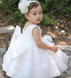 White Oversized Bow Back Baby Girl Lace Flower Dress Perfect for Birthday, Wedding, Christening, Baptism, Party Dress Or Baby Shower Gift. Available from Newborn - 15 Years Color: White Material: White lace, soft polyester fabric, satin, purified cotton lining. #flowergirldresses #whitebaptismdress #communiondresses #fancylacedress #littlegirllacedress #lacedress #girldresses #kids clothing