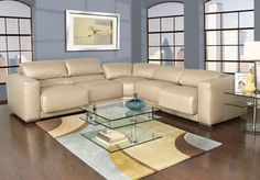 This Friday at Kane's you can save $600 off the retail price on this beautifully modern Ella 3-piece Sectional Leather Sofa!
