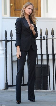 Model behaviour: Showcasing her endless lean legs in fitted slightly flared trousers, she accentuated her statuesque figure in patent pointy killer heels.