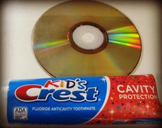 Fix scratch, freezing, and skipping CDs and DVDs with toothpaste. Put a few drops on the disc, enough to cover but not be really goopy. Use your fingers to buff the disc until the toothpaste is partly dry and feels tacky. Put pressure on the rubbing so it is rubbed in really well. Rinse well with warm water (toothpaste comes off easily). Pat dry with a soft cloth.