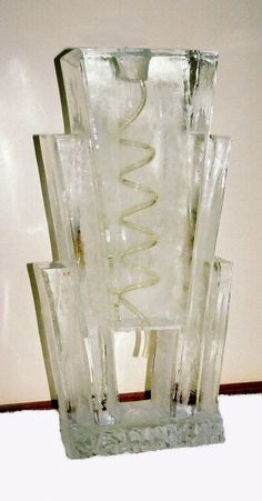 ice sculpture luge, put signature drink at bottom to fill
