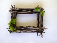 Moss and flowers give the frame a spring look.