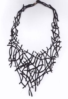 leather cut-out necklace (easy to do with the laser-cutter, just maybe not leather)