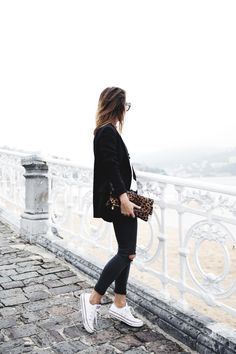 A variation of the black skinnies with white Converse. Simply add a black blazer and a different colour clutch and you are good to go. Via Sara EscuderoBlazer: Zara, Top:Lovers & Friends, Jeans: Topshop,Clutch: Clare Vivier,Sneakers: Converse