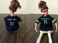 """Seahawks 12th Man Spirit Photo from Carolyn Evans """"My Granddaughter (3 yrs old)says that all of her Disney Princess dolls are Seahawks fans and she wants them each to have a jersey. So I am making these Jersey's for each of her dolls and the ones that she will get for her birthday. There is a total of 17 that I am doing all with different players on them. She wants them before the next game."""""""