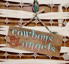 Cowboys and angels. Cute country sign!