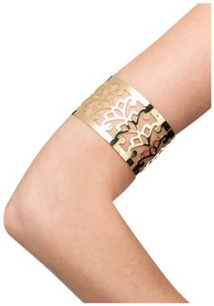Gold Goddess arm cuff or arm band. It has a sort of filigree design.