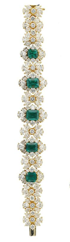AN ATTRACTIVE EMERALD AND DIAMOND SUITE   The V-shaped necklace designed as seven graduated rectangular-shaped emerald and diamond clusters to the two-row brilliant-cut diamond backchain, with bracelet, ear clips and ring en suite, necklace 40.0 cm, bracelet 17.0 cm long