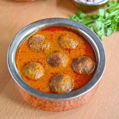 Raw Banana (plantain/kela) fried dumplings in spiced onion tomato curry or gravy. Good side dish with roti, paratha, poori, rice, pulao.