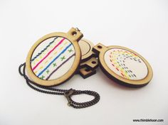 Check out this item in my Etsy shop https://www.etsy.com/uk/listing/265625710/mini-embroidery-hoop-necklace-sewing-kit